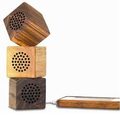 This cube of a speaker is made of 100% natural bamboo and wood. Display it on your desk and play your music from your iPhone.  Measures: 2H x 2W Material: bamboo/wood USB charger and 3.5mm cable included