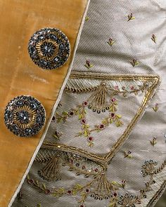 Gentleman's Ensemble - detail of frockcoat buttons and waistcoat embroidery  Date: ca. 1765  French  Medium: silk, metal
