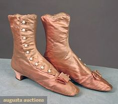 "Lady's high button boots, c1870's;   Pink silk satin, white glass buttons, bows on vamps, low heel, L 9.5"", W 2.25"", Ht 8.25"""