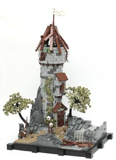 I love the decay portrayed in this abandoned LEGO castle watch tower. And I love the use of the new olive green LEGO leaves.