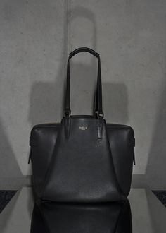 • BLACK OFFICE BAG • Timeless office bag made out of Italien calf leather. Three compartments, several lining pockets and a good sense for stylish business ladies. #officebag #shopper #leather #calf #accessories #bag #handbag #timeless #black #timeless #minimal #reduced #modern #contemporary #fashion #signature #trendy #raellezurich www.raellezurich.com Bag Making, Making Out, Black Office, Contemporary Fashion, Calf Leather, Business Women, Calves, Minimal, Handbags