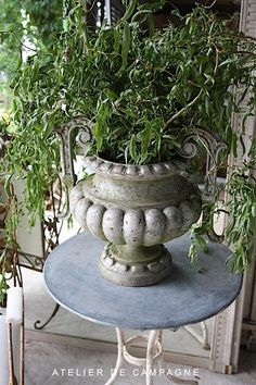 #19/089 Cast iron Urn with handles on table