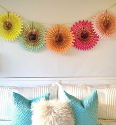 pretty paper fans = affordable wall decor  http://glo.msn.com/living/best-party-accessories-under-20-8189.gallery?photoId=100396