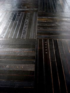 Leather belt flooring. The leather smell would be awesome.Inspiration only!!
