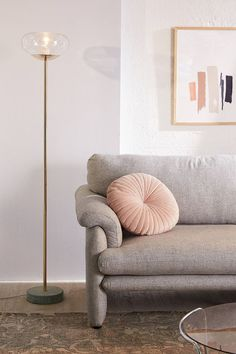gray couch and pink round pillow