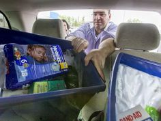 Salem Kallas loads totes into his van (donated to his family by the Syrian Refugee Support Group) at the Rundle Superstore in Calgary on Thursday, May 5, 2016.
