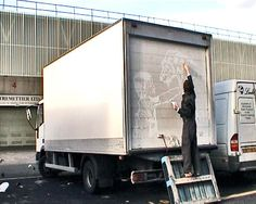 Ben Long The Great Traveling Art Exhibition  Using his finger to scribe into the layer of dirt built-up from exhaust emissions, Long creates elaborate drawings on the rear shutters of white haulage trucks.