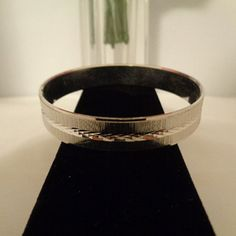 Classic  Trifari Vintage Silvertone Bangle Bracelet with Elegant Stripe Design in Middle. You can see more photos of this bracelet plus over 200 items that are on sale for the weekend. Free Shipping to the US. The Sale is on for the Weekend Only. Make sure you stop by our store www.CCCsVintageJewelry.com