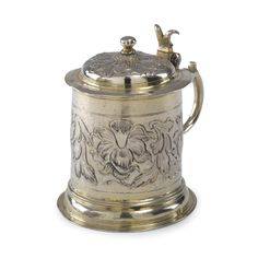 A GERMAN SILVER-GILT MINIATURE TANKARD, MARX MERZENBACH, AUGSBURG, 1655-60 the body chased with flower heads and foliage, hinged lid, also struck with a 1806-7 Austro-Hungarian mark for Brünn, marked at the base and rim of lid