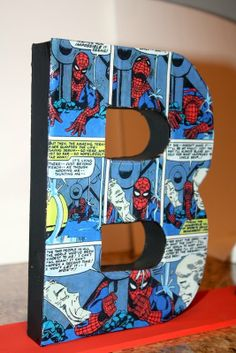 superhero centerpieces - LOVE this! Comic pages!! @Stephanie Goldfarb