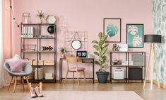 Black chair at desk with laptop next to a ficus in workspace interior with posters and pink armchair , Rugs In Living Room, Living Room Decor, Hardwood Floor Colors, Workspace Inspiration, Interior Design Companies, Pink Rug, Pink Walls, Metal Wall Decor, Metal Walls