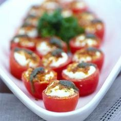 Roma tomatoes stuffed with goat cheese make a perfect pick-up appetizer. Serve at room temperature for a gooey, cheesy bite.