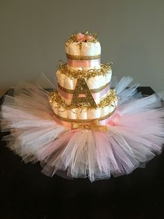 Pink and Gold Diaper Cake with Custom Tutu Skirt in Pink and White  Diaper Cake by The Bling Factor! www.blingfactorevents.com IG: @theblingfactor facebook.com/theblingfactor blingfactorinc@gmail.com
