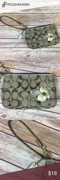 Spotted while shopping on Poshmark  Coach Wristlet Signature Print Flower  Design Gold! 97700075fa