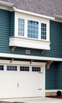 Garage door trim detail / TG: Love the idea of bumping our windows out on the front of our house over the garage like this!!