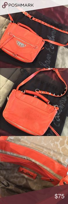 Sam Edelman edgy orange crossbody (pre-loved) Gorgeous colored for spring! Leather crossbody, fits so much including a long larger wallet, keys, phone and some lip stick! Very roomy and super edgy. Strap has spikes on it for some extra pizazz🖤. You will love rocking this! Hardware is silver on a bright orange leather. Interior is super clean - no sign of wear other than the back of the back which can be cleaned with some leather cleaner tricks! EXTRA: comes with dust bag! Sam Edelman Bags…