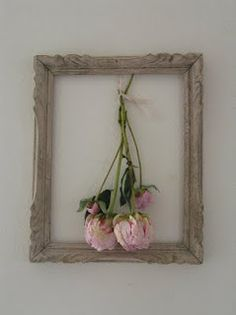 empty picture frame & dried rose