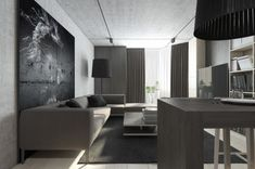 This Moscow loft is just a bit softer than the previous spaces. The use of concrete gray and lighter upholstery along with light wood paneling skews the space more towards neutral. The bedroom becomes a warm retreat with its cushy bed and encapsulated feeling, while still giving the slumberer some privacy.