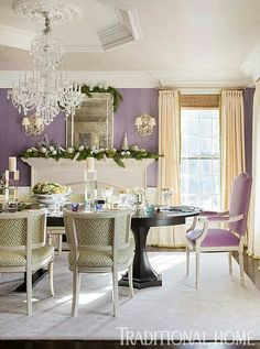 This room is fit for a queen. Lavender walls and a crystal chandelier set an elegant tone. White and silver holiday decorations complement the regal feel of this dining room. Green sprigs and white flowers freshen the space. Purple Dining Chairs, Lavender Walls, New England Homes, Dining Room Walls, Queen, Traditional House, Christmas Home, Beautiful Homes, Room Decor