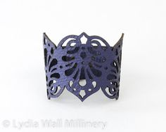 Leather cuff made of Purple leather laser cut in intricate design inspired by Victorian times.    Measures 7, 7 1/2 or 8 inches(18,19 or 20