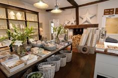 Pull elements from this, baskets, long table with products, add live plants/greenery for height