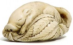 Wild Boar asleep among leaves- Antique Ivory Netsuke