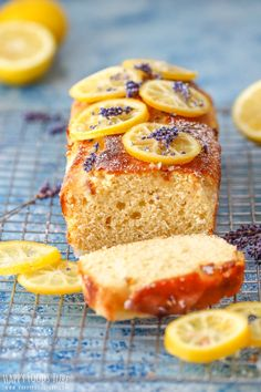This Easy Lemon Lavender loaf is refreshing citrus bread full of goodness! Top i… This Easy Lemon Lavender Bread is a refreshing citrus bread full of goodness! Cover with candied lemon slices or icing and enjoy with a cup of coffee. Candied Lemon Slices, Candied Lemons, Lemon Loaf Cake, Lemon Bread, Loaf Recipes, Baking Recipes, Dessert Recipes, Cake Au Miel, Lavender Cake