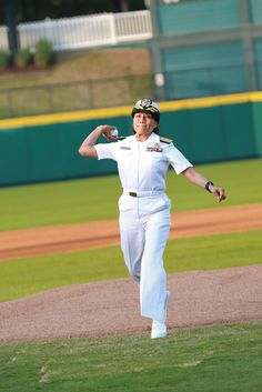 Rear Adm. Raquel C. Bono, chief of the Navy Medical Corps, throws the first pitch at a baseball game during Dallas-Fort Worth Navy Week. #Navy #USNavy #AmericasNavy navy.com