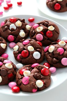 Double Chocolate M&M Cookies Recipe - soft and chewy pudding cookies packed with cocoa powder, semi-sweet chocolate chips, white chocolate chips and bright red and pink M&M's! Make a batch and bake it - all in 30 minutes!