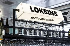 """In another rare foray into the world of commercial interior design, we bring you this rather lovely project from Karlssonwilker, which created the designs for a bar in Keflavík International Airport in Iceland. The consultancy created everything from the name to the signage to the menu graphics, and the concept carries through each beautifully. The name Loksins was chosen, meaning """"finally"""" in Icelandic, with the idea that the bar welcomes passengers arriving and departing to and from the…"""