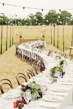 Love the winding reception tables & the hanging exposed lightbulbs! Wait for nightfall--so romantic!  // photo by Louisa Bailey // http://ruffledblog.com/melbourne-rustic-wedding