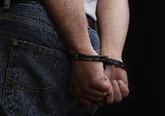 Handcuffed man | Image source: Drugfree.org