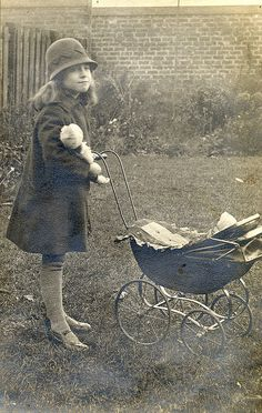 Child with doll's pram in the 1920s