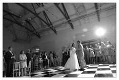 A vintage inspired first dance for this wedding couple on a checkerboard dance floor -  www.jsmoran.com