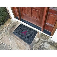 """Atlanta Braves Doormat.  Adorned with the Braves logo, these door mats make a statement while keeping dirt and mud from entering your home.  Heavy duty vinyl construction ensures a durable mat and the mat measures 19""""x30"""".  Deep reservoir contains water and debris.  Rugged ribs scrape shoes clean.  The Atlanta logo is full color printed construction. Wow your guests with these door mats!"""