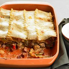 This traditional pasta dish gets a new angle with ingredients such as spicy andouille sausage, chicken, sweet peppers, and Cajun seasoning: http://www.bhg.com/recipes/chicken/casseroles/crowd-pleasing-chicken-casseroles/?socsrc=bhgpin051414andouillechickenlasagna&page=4
