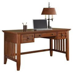 Oak wood writing desk with lattice moldings and slatted sides.   Product: Writing deskConstruction Material: Ha...
