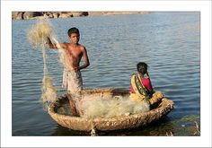 Coracle. Hampi  Fishing on a coracle in the river, ampon the granitic rocks.  Coracle is a basketry boat.
