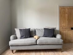 Grey is a wonderful colour for a sofa, as it's easily styled to match every season. Our customer Jessi styled her British handmade Alwinton sofa in this gorgeous House Wool Mercury fabric to create a cosy ambience.  Now that we're heading towards the cooler months, how will you adapt your living room?  Visit your nearest showroom for more inspiration or shop online today.  #sofasandstuff #interior #interiors #interiordesign #sofa #sofas #greysofa #woolsofa #greyhome #neutralsofa Neutral Sofa, Traditional Sofa, Sofa Inspiration, Going Gray, Contemporary Furniture, Mercury, Showroom, Cosy, Sofas