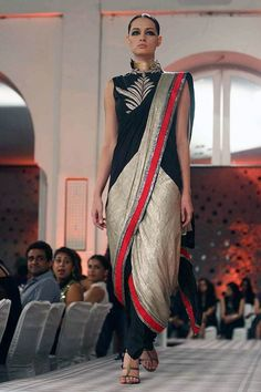 In love with Anamika Khanna's dhoti saris. Will try to re-create this look with my off white kasavu saree and marron blouse with an embroidered vest.: