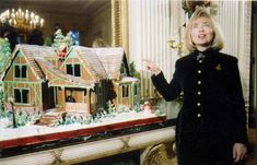 White House Gingerbread | (1994) First Lady Hillary Clinton poses with a replica of the President's boyhood home.