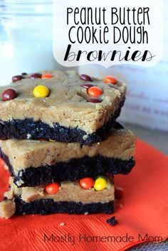 Peanut Butter Cookie Dough Brownies - fudgy brownies layered with peanut butter cookie dough and topped with Reeses Pieces, yes please!!