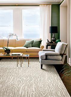 FLOR tiles, perfect for the hall way.  Rip up carpet, paint plywood and add tiles.