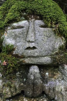 """ ""The moss seems to be a real hair on this stoned statue. Located: Otagi-Nenbutuji Temple, Oku-Saga, Arashiyama area, Kyoto."" Text and Photography by Teruhide Tomori of..."