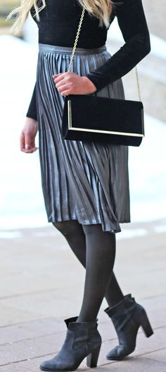 The most stunning pleated skirt! For under $25 - it's a steal! | Fashion blogger Mash Elle styles a @DynamiteStyle pleated skirt with a velvet bodysuit and black booties.