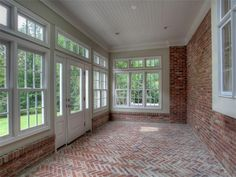 A Sun Room Closed In Porch Under Deck On Water Side