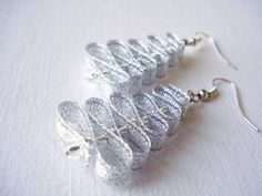 The earrings have unique design. They are made of shining ribbon and even more shining glass beads.  Light, shining and so festive!    Earrings are 5,5