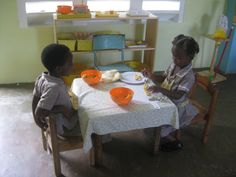 Chepstowe Early Learning Centre;Jamaica Watching banana slicing