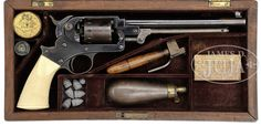 RARE CASED STARR SINGLE ACTION ARMY REVOLVER. SN 15. Cal 44. Extremely early example, completely unmarked except for serial numbers. All blue finish with 8″ rnd bbl, dovetailed target style front sight with rear sight in hammer nose. Cylinder is unfluted with 12 stop notches. Mounted with extremely rare, checkered, 1-pc ivory grip that has plain butt cap with matching serial number.