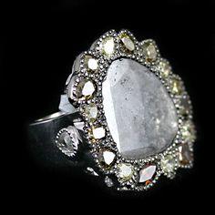 Diamond Slice Ring accompanied by 5.56 carats of Diamonds.